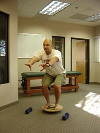wobble board squatting two feet
